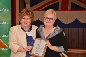 Honourable Heather Klimchuk presenting Dr. Carolee Pollock with plaque at the 2012 AHRF Heritage Awards.