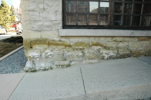 De-icing salts applied to a ramp likely contribute to this sandstone masonry failure.