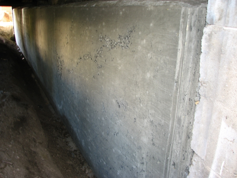 Proposed Solution: Medium - Containment – pour new foundation wall against the old to stop the structural failure.