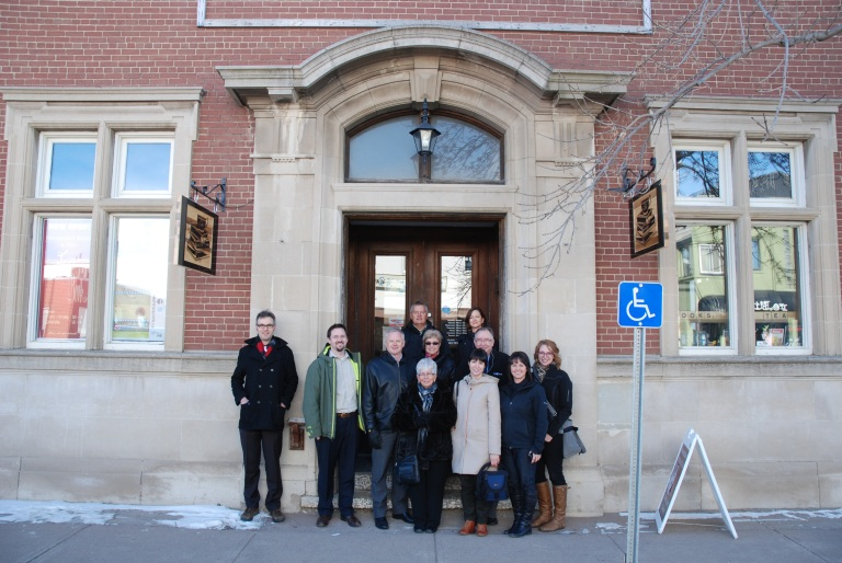 Alberta Main Street Program staff and Coordinators outside the historic Bank of Commerce Building in Olds.