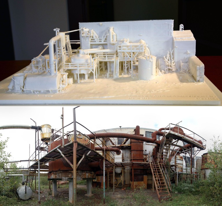 an image contrasting a scale model of the sulphur plant with the plant itself