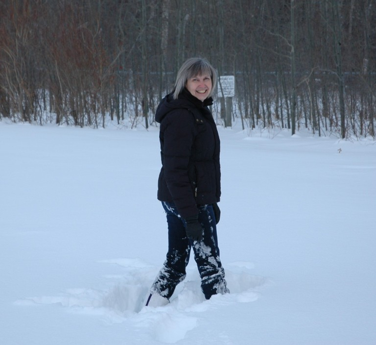 A photograph of Anna Curtis, Head of Land Use Planning, working at a site in the Cypress Hills.