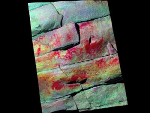 3D rendering of point cloud data from laser scan at Okotoks with enhanced photography overlaid. Red areas are red ochre paint; note square-bodied human figure at upper left.