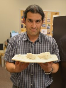Alireza Farrokhi holding 1:200 scale model of the Big Rock