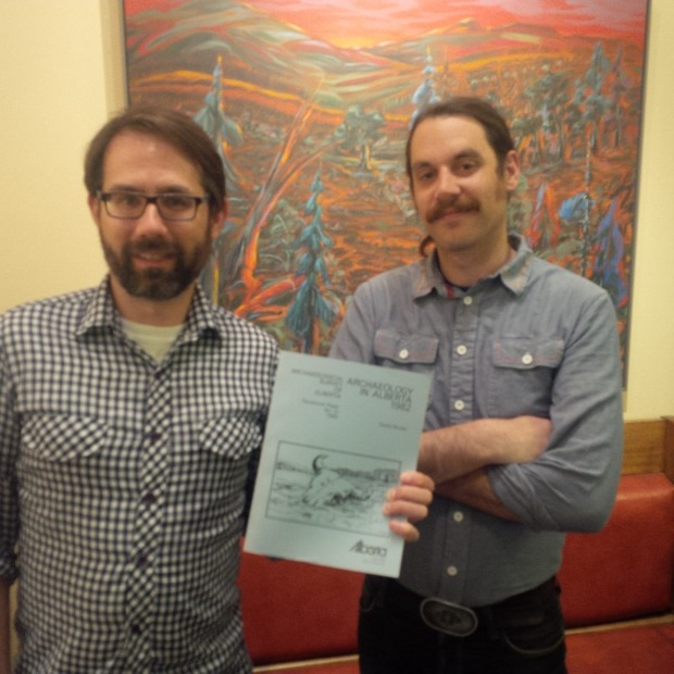 Robin Woywitka, Cultural Land Use Analyst, and Jared Majeski, Heritage Division Web Assistant, proudly display a hard copy of one of the Occasional Paper series.