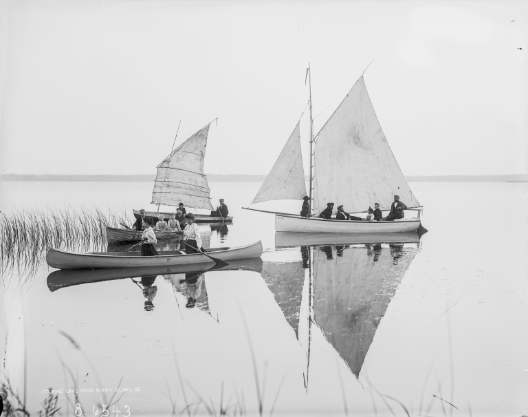 The gaff-rigged sloop Mudhen becalmed at Koney Island, along with two canoes, one with a small sail as was popular at the time. (Courtesy of the Provincial Archives of Alberta, B. 6543.)