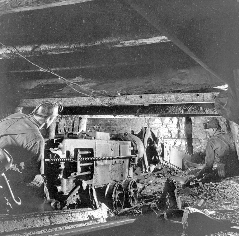 Miners using a universal coal cutter at Lethbridge Collieries, ca. 1950 Source: Provincial Archives of Alberta, A9908