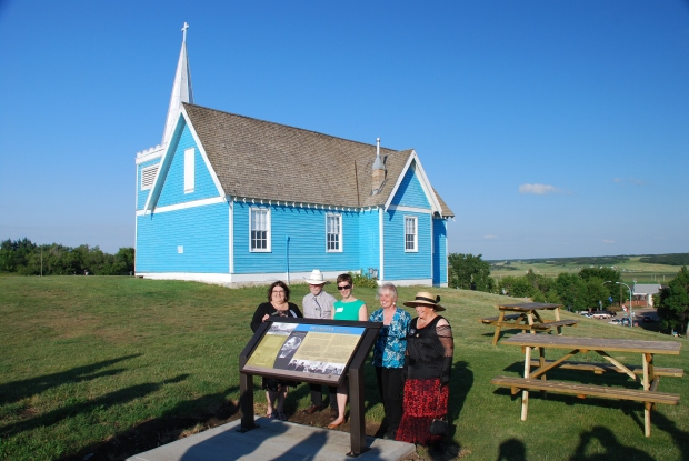 The unveiling of the St. Edmund's heritage marker coincided with the Big Valley centennial and homecoming celebrations that took place August 1 – 3, 2014. L to R: Gail Knudson, Mayor of Big Valley; Asaph Johnson, Village Councillor; Brenda Manweiler, Historic Places Research and Designation; Lois Miller, Village Councillor and Director, Big Valley Historical Society; Trudy Spence, Secretary, Big Valley Historical Society