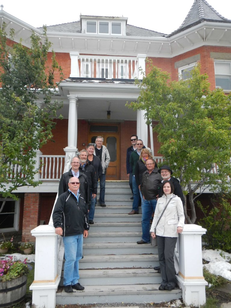 The Board of the Alberta Historical Resources Foundation, on the steps of Lebel Mansion, the Town of Pincher Creek's first designated Municipal HIstoric Resource.
