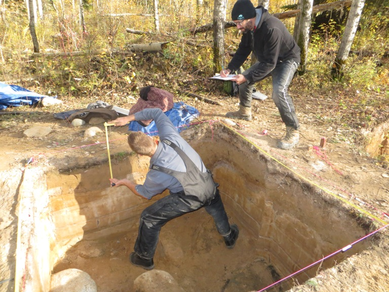 Alberta Culture and Tourism staff members Robin Woywitka, Cultural Land Use Analyst, and Todd Kristensen, Northern Archaeologist, recording stratigraphy at an excavated site in the Fort McMurray region, October 2013. (Photo courtesy of Robin Woywitka.)