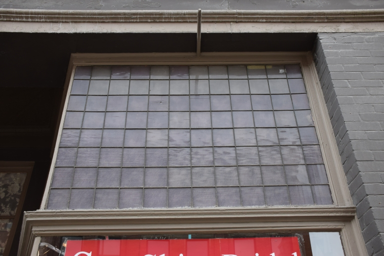 An original prism (or possibly reeded) glass transom window on the Bell Block, a large late commercial style building on Macleod Trail in Calgary (Courtesy of Fraser Shaw, Historic Resources Management Branch).