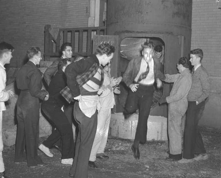 Students using the fire escape slide at St. Stephen's College, October 1940  (Courtesy of the University of Alberta Archives, UAA 72-58-0294).