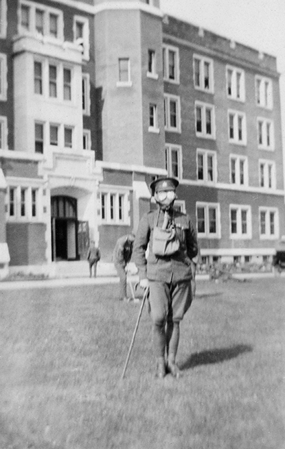 A soldier wearing a gas mask in Front of the Alberta College Building (now Old St. Stephen's College), ca. 1917.  (City of Edmonton Archives, EA-63-115).