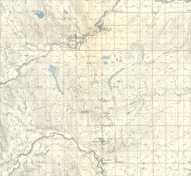 Detail of the 1945 edition of NTS Map Sheet 82 J/09. Royalties and Longview are at the south end of the map. Although smaller than both Turner Valley and Black Diamond to the north, the two boom towns are shown as being of considerable size.   Source: Department of Mines and Resources. Map 819A, Turner Valley, West of the Fifth Meridian, Alberta. Scale 1:63,360 (1 Inch to 1 Mile), 82 J/09. Ottawa: Government of Canada, 1945. Available from Natural Resources Canada. GeoGratis http://geogratis.gc.ca/geogratis/Home?lang=en.