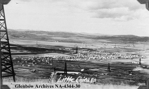 Little Chicago (Royalties), Alberta, 1940. Like Little New York (Longview) to the south, Little Chicago, or Royalties, developed quickly after the 1936 oil strike in Turner Valley. The unofficial name was likely a sarcastic reference to the frantic pace of development at the town site, or a not-so-polite reference to a local shopkeeper. (Glenbow Archives, NA-4344-30).