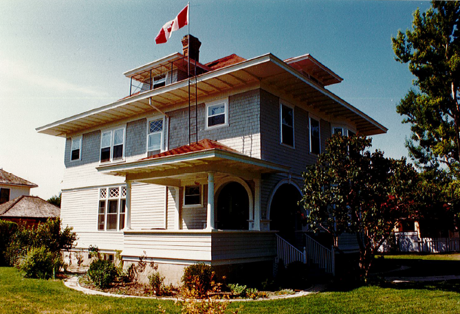 Exterior of Annandale from the northeast, 1986; showing the entry porch, dormer windows and chimney. Alberta Culture and Tourism, Government of Alberta.