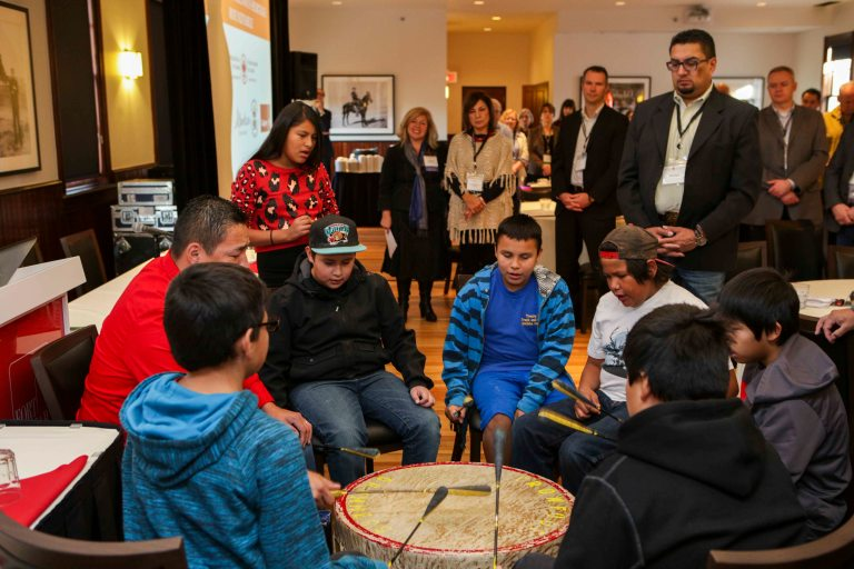 The Crowfoot Young Warriors kick off Moh-Kins-Tsis: Calgary Indigenous Heritage Roundtable with drumming and song. Photo credit: Pinpoint Photography, courtesy of the National Trust for Canada.