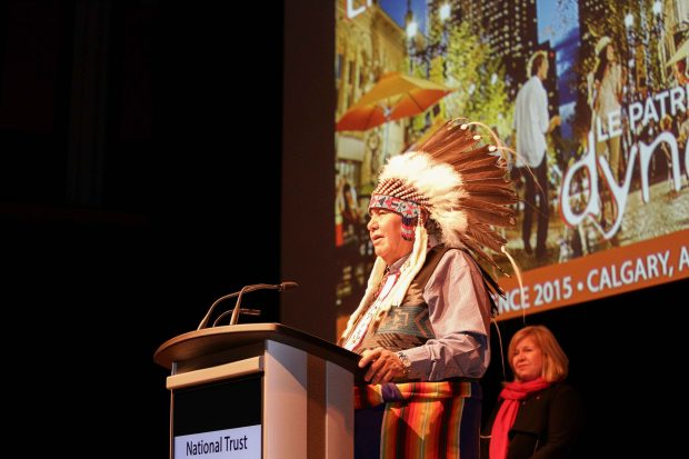Dr. Reg Crowshoe, spiritual advisor and former Chief of Piikani Nation, provides opening remarks at the conference's evening keynote session. Photo credit: Pinpoint Photography, courtesy of the National Trust for Canada.