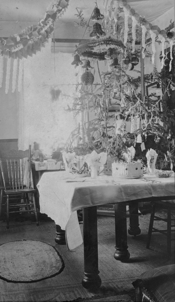 Christmas tree and table set with food, Levason house, Lake Saskatoon, Alberta, 1925. Photo Credit: Provincial Archives of Alberta, A14875
