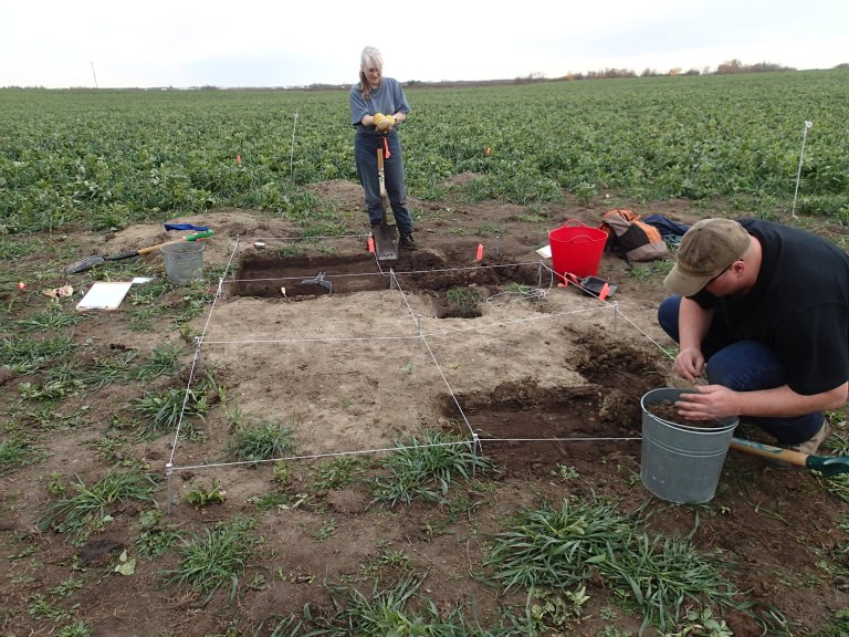 HRMB staff members Wendy Unfreed (Plains Archaeologist) and Aaron Wilson (Aboriginal Consultation Advisor) working at the excavation site.