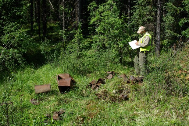 Archaeologist recording a can scatter feature at the site, 2010 (Photo Credit: Lifeways of Canada Ltd.)