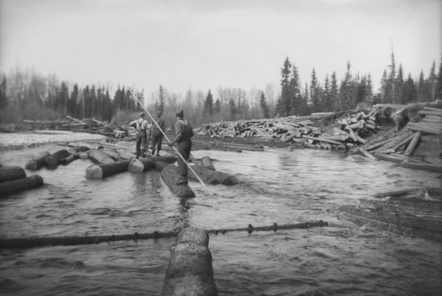 Men floating lumber, late 1930's (Photo Credit: Provincial Archives of Alberta, A3787)
