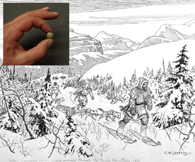 A collection of musket balls found in 1921 (like the one featured in the inset) have been traced back to David Thompson who is featured here crossing Athabasca Pass in the Rocky Mountains by snowshoe in 1810-11. Library and Archives Canada, Acc. No. 1972-26-9.