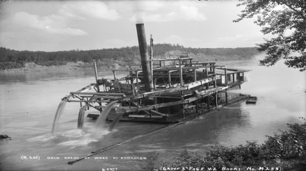 Steam-powered gold dredge at work along the North Saskatchewan River, 1898. Source: Provincial Archives of Alberta, B5327