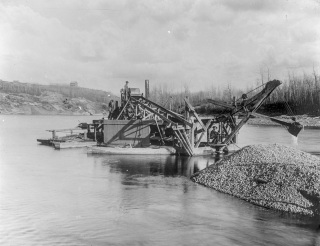 Gold dredge at work along the North Saskatchewan River, ca. 1890. Source: Provincial Archives of Alberta, B5332