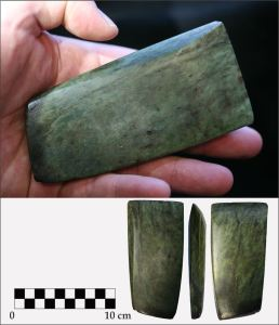 Nephrite celts are highly polished with a flat and slab-like shape. This specimen was found near Stony Plain outside of Edmonton.