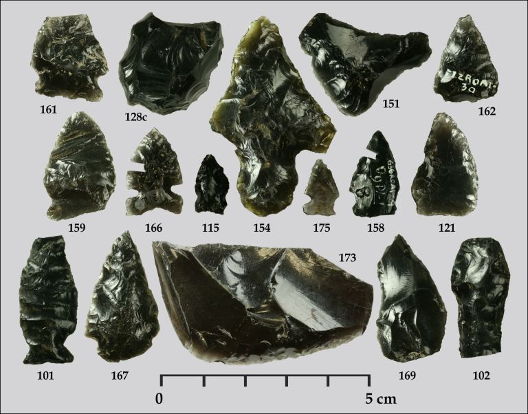 These obsidian artifacts were recovered from Waterton, Banff, Jasper, Yoho, and Kootenay National Parks in the Northern Rockies and have been sourced by a team from the University of Georgia and the Royal Alberta Museum back to their volcanic origins using a technique called X-ray fluorescence. Most obsidian along Alberta's Eastern Slopes is either from Bear Gulch in Idaho, Obsidian Cliffs in Wyoming, or Edziza in northwest British Columbia. This suggests that people of the mountains maintained widespread trade networks. Note that specimens 158 and 166 have small sections cut from them by analysts who attempted to determine how old the projectile points are using a technique called obsidian hydration dating (by Todd Kristensen).
