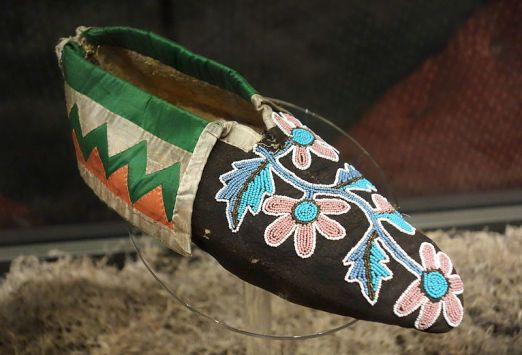 Cherokee moccasin, 1815-1840. Exhibit in the Bata Shoe Museum, Toronto, ON, Canada. Public Domain. Photography was permitted in the Museum without restriction. https://commons.wikimedia.org/wiki/File:Cherokee_moccasin,_1815-1840_-_Bata_Shoe_Museum_-_DSC00632.JPG