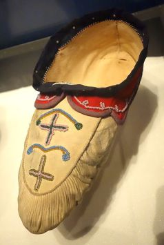 Naskapi moccasin, late 1800s. Exhibit in the Bata Shoe Museum, Toronto, ON, Canada. Public Domain. Photography was permitted in the Museum without restriction. https://commons.wikimedia.org/wiki/File:Naskapi_moccasin,_late_1800s_-_Bata_Shoe_Museum_-_DSC00714.JPG