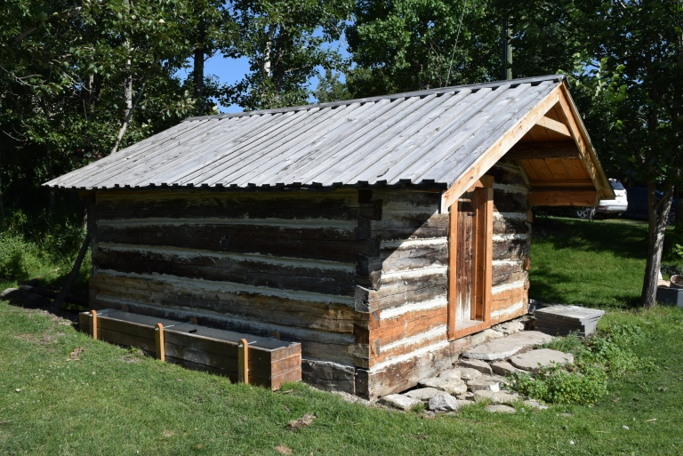 The Spring House upon completion of the conservation work in July 2019, with the horse watering trough reconstructed from fragments of the earlier element. Well-concealed screw pile supports keep the timbers just out of the creek bed and secure the structure in the event of torrential floods from the hills. Source: Historic Resources Management Branch.