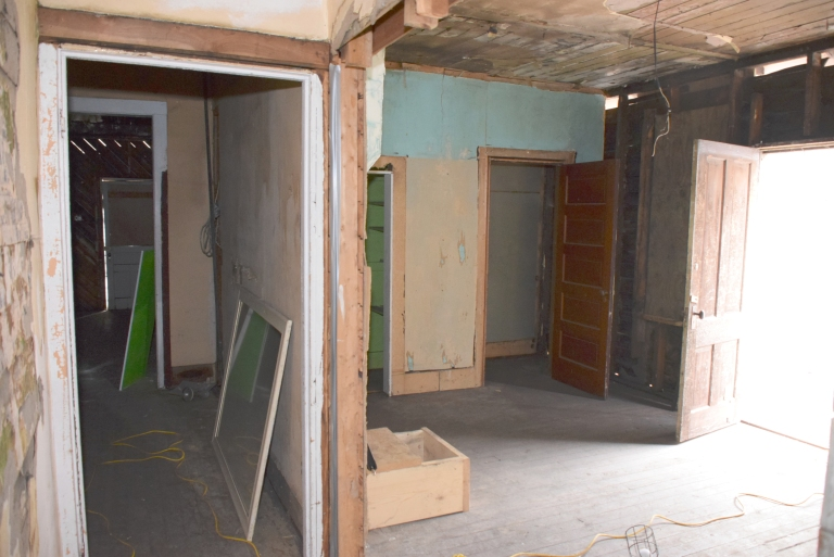 In June 2016, the interior had suffered extensive water damage from roof leaks and moisture penetration through the exterior walls. A welter of finishes recorded decades of change and included the varnished tongue-and-groove walls and ceilings of the former APP office, linoleum flooring and wallpapers dating from the 1930s to the 1960s, and many layers of lead paint.