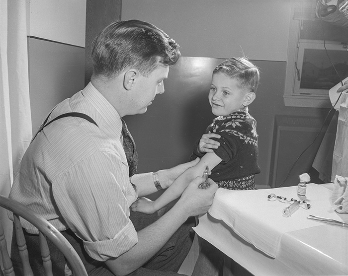 Dr. Ball giving polio vaccinations, Queen Mary Elementary School, 1956. Source: Provincial Archives of Alberta, Photo PA 2887/2.