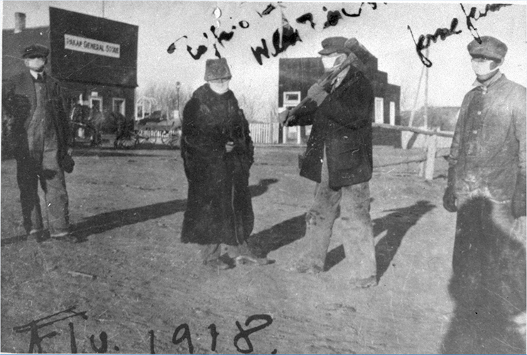 (Above) People by Pakan General Store with masks, 1918. Photo UV6. (Below) School boys and M.J.C. Levason (lay reader) wearing masks because of the 1918 influenza scare, St. Peter's Anglican mission, Lesser Slave Lake.  Photo A14803