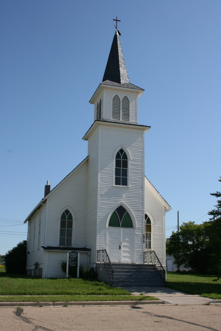 Holden Lutheran Church. The tall steeple of this church is visible throughout much of the community, where it is valued as a recognized and prominent landmark.